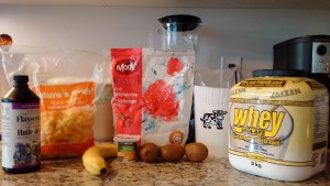 Shake ingredients: banana, kiwi, frozen raspberries, strawberries and mango, milk, whey protein, milk, yogurt.